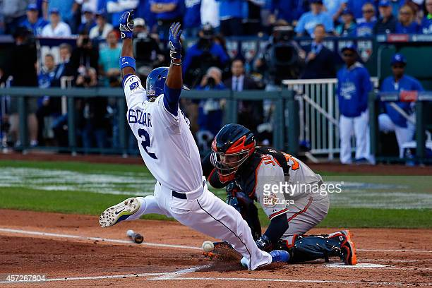 Alcides Escobar of the Kansas City Royals scores on Eric Hosmer of the Kansas City Royals grounder into fielder's choice to first base against Miguel...