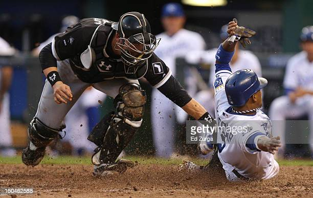 Alcides Escobar of the Kansas City Royals scores past the tag of Tyler Flowers of the Chicago White Sox in the fifth inning at Kauffman Stadium on...