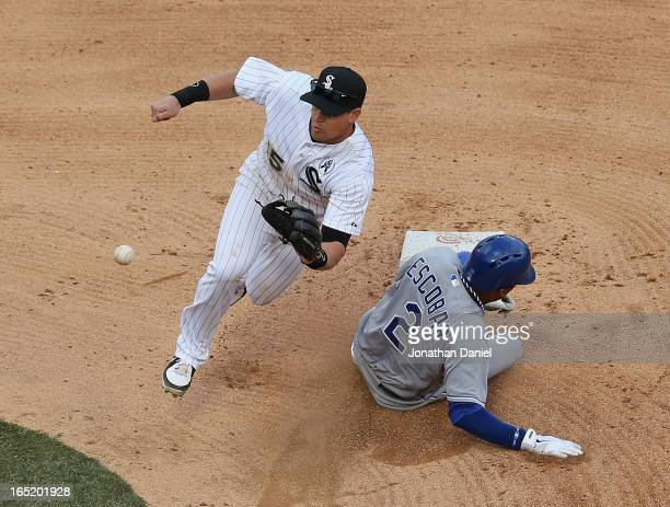 Alcides Escobar of the Kansas City Royals steals second base as Gordon Beckham of the Chicago White Sox awaits the throw during the Opening Day game...