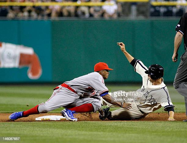 Alcides Escobar of the Kansas City Royals tags out Jordy Mercer of the Pittsburgh Pirates during interleague play on June 9 2012 at PNC Park in...