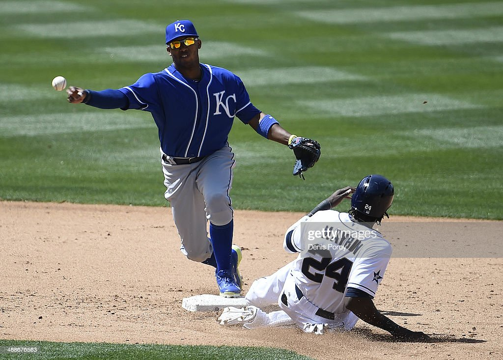 Alcides Escobar #2 of the Kansas City Royals throws over Cameron Maybin #24 of the San Diego Padres as he turns a double play during the sixth inning of a baseball game at Petco Park May 7, 2014 in San Diego, California.