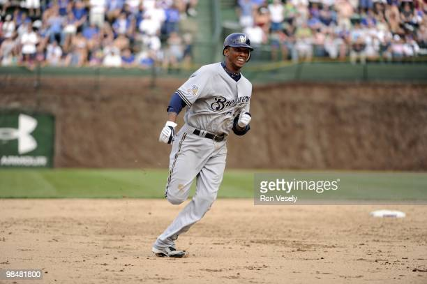 Alcides Escobar of the Milwaukee Brewers slides into third base after hitting a triple against the Chicago Cubs on April 14 2010 at Wrigley Field in...