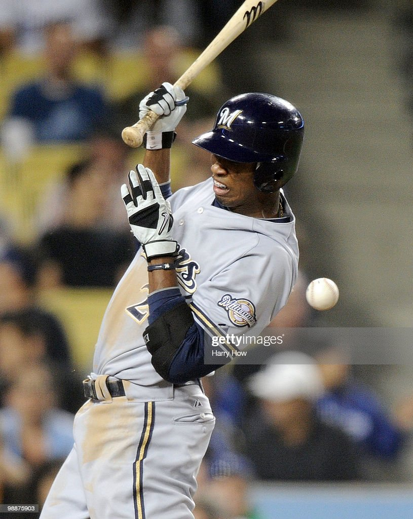 Alcides Escobar #21 of the Milwaukee Brewers winces as he is hit by a pitch by Todd Billingsley #58 of the Los Angeles Dodgers during the fourth inning at Dodger Stadium on May 5, 2010 in Los Angeles, California.