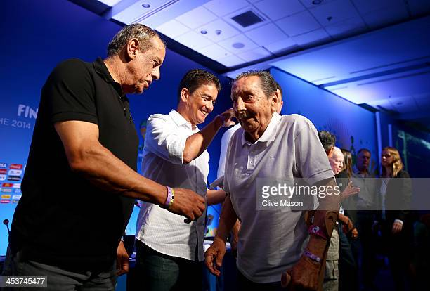 Alcides Ghiggia greets Carlos Alberto Torres on stage after the FIFA World Cup Ambassadors Press Conference during a media day ahead of the 2014 FIFA...