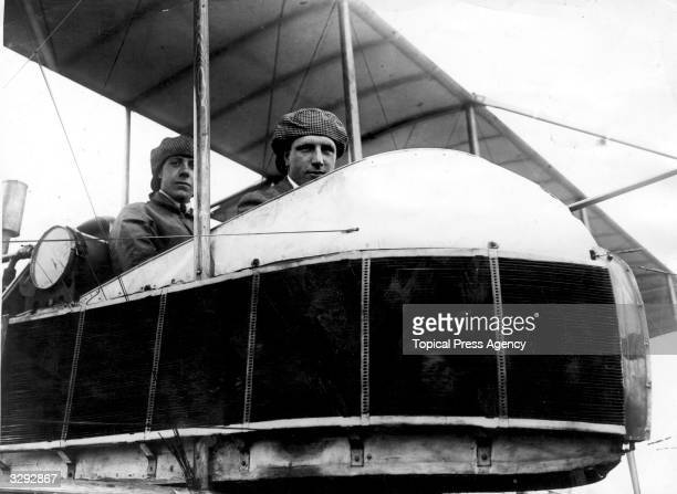 Alcock and Brown in the cockpit. John Alcock met his death in December 1919, 30 miles from Rouen, after colliding with a tree.