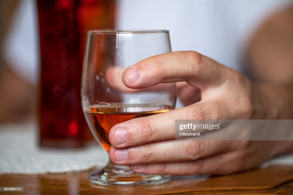 Alcohol addicted man drinking strong alcohol alone at home. : Stock Photo