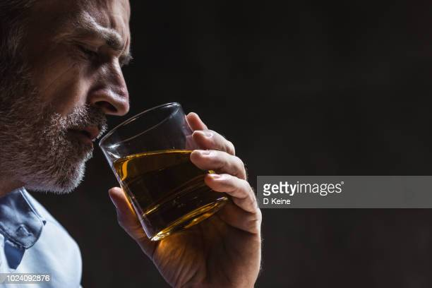 alcohol addiction - whisky stock photos and pictures