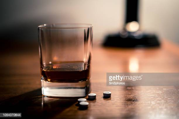 alcohol and opioids a deadly combination - hydrocodone stock pictures, royalty-free photos & images