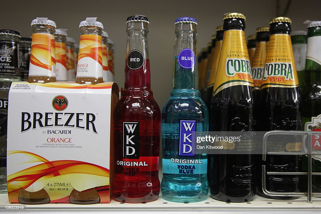 Alcohol lines shelves in an Off Licence named 'Little Store Cheap Booze', in Thornton Heath on February 21, 2011 in London, England. Doctors have warned that inadequate regulations on alcohol may cost the lives of around 250,000 people in England and Wales over the next 20 years. A minimum price of 50p per unit is urgently needed, according to leading liver disease specialists.