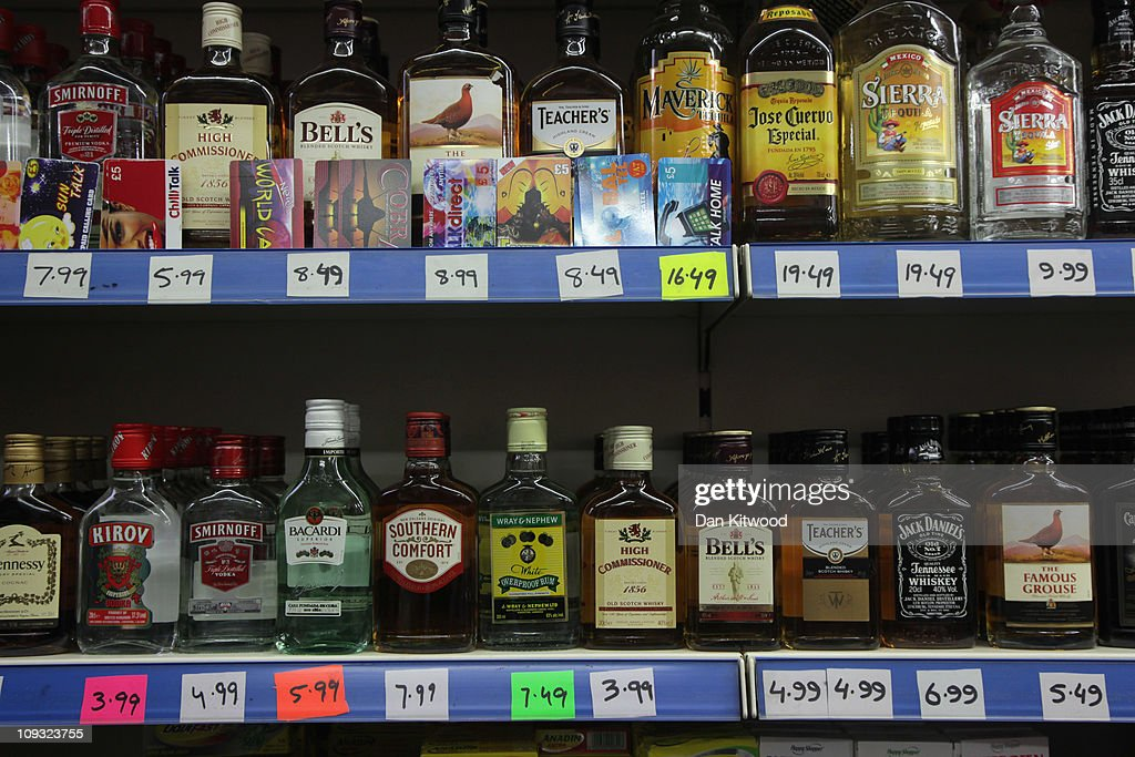 Alcohol lines shelves in an Off License in Brixton on February 21, 2011 in London, England. Doctors have warned that inadequate regulations on alcohol may cost the lives of around 250,000 people in England and Wales over the next 20 years. A minimum price of 50p per unit is urgently needed, according to leading liver disease specialists.