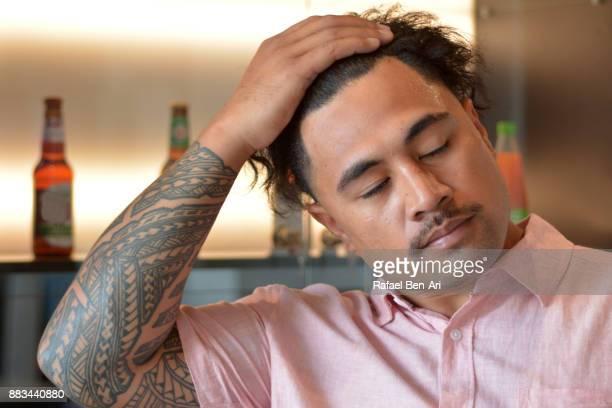 Alcoholic addict Maori man in a bar