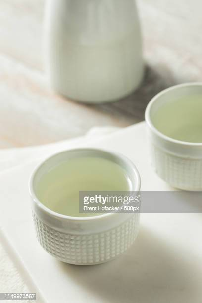 alcoholic japanese sake rice wine - plastic plate stock photos and pictures