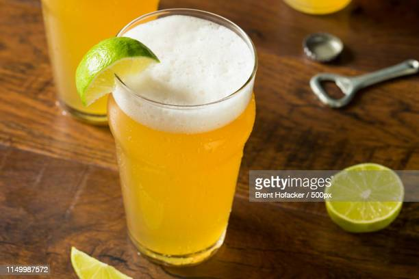 alcoholic refreshing mexican beer with lime - drunk mexican stock pictures, royalty-free photos & images