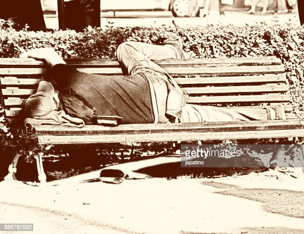 Alcoholic sleeping on the benches of a park