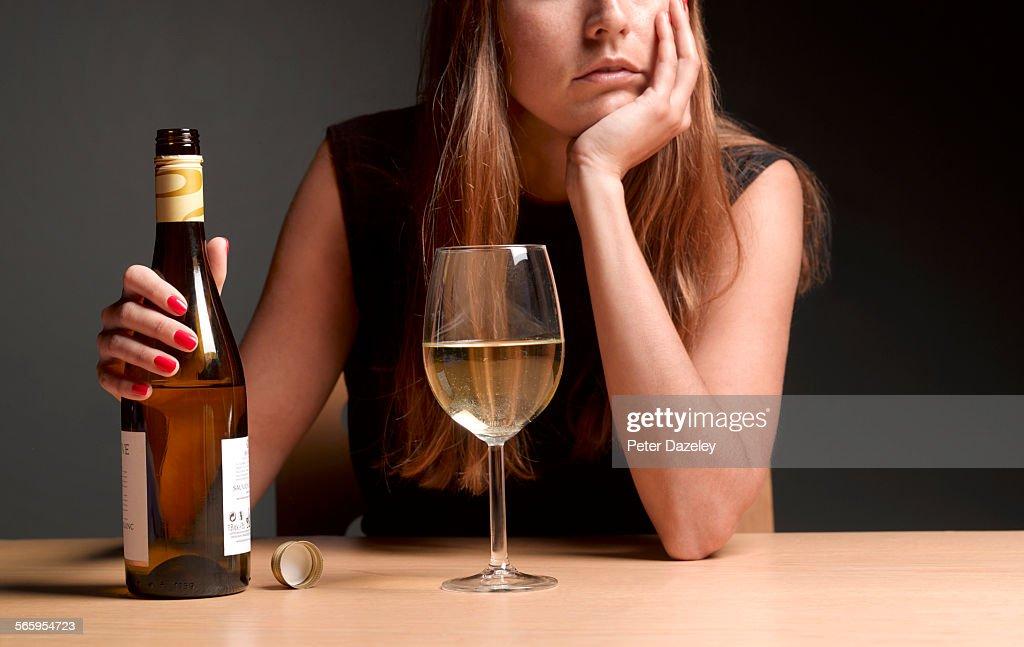 Alcoholic women with depression : Stock Photo
