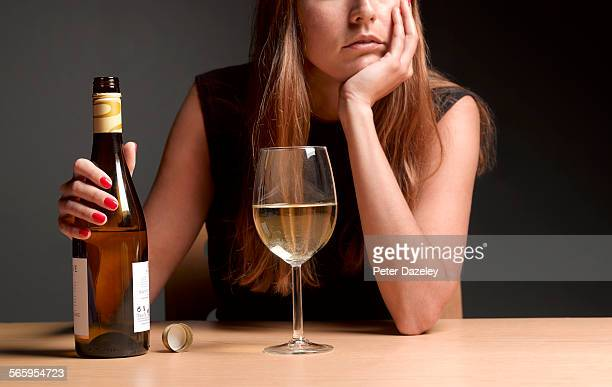 alcoholic women with depression - refreshment stock pictures, royalty-free photos & images