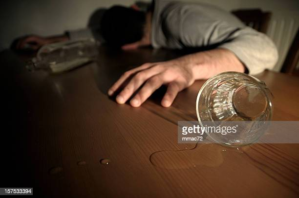 Alcoholism Concept Man Drunk Laying on the Table