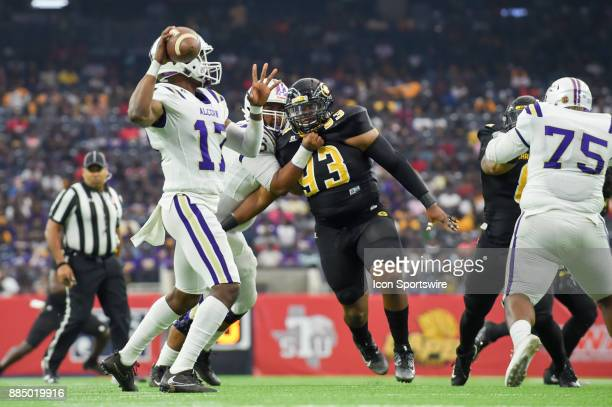 Alcorn State Braves quarterback Lenorris Footman looks to throw to the flat as he receives pressure up the middle from Grambling State Tigers...