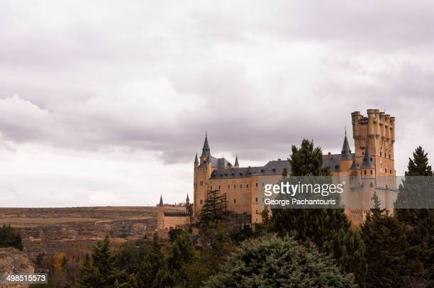 Alcázar of Segovia on a rock above the confluence of Eresma and Clamores rivers near the Guadarrama mountains in central Spain.