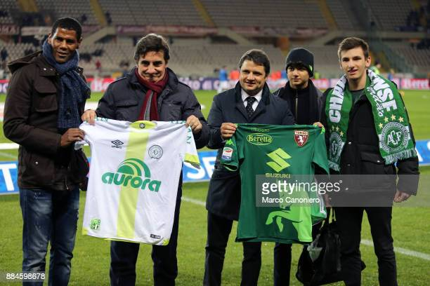 Aldair and chairman of Torino FC Urbano Cairo show the shirt in honor of the tragedy of the Chapecoense team during match between Torino FC and...