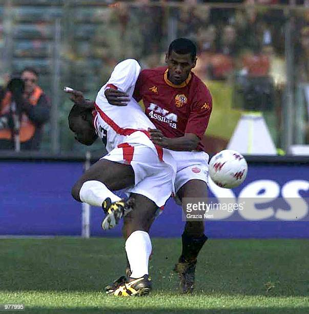 Aldair Dos Santois of Roma and Michael Ugochukwu Enyinnaua of Bari in action during the SERIE A 14th Round League match between Roma and Bari played...