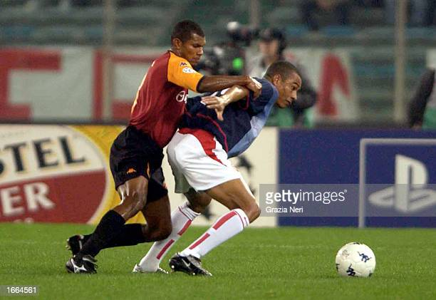 Aldair of Roma and Gilberto Silva of Arsenal in action during the UEFA Champions League Second Phase match between AS Roma and Arsenal played at the...