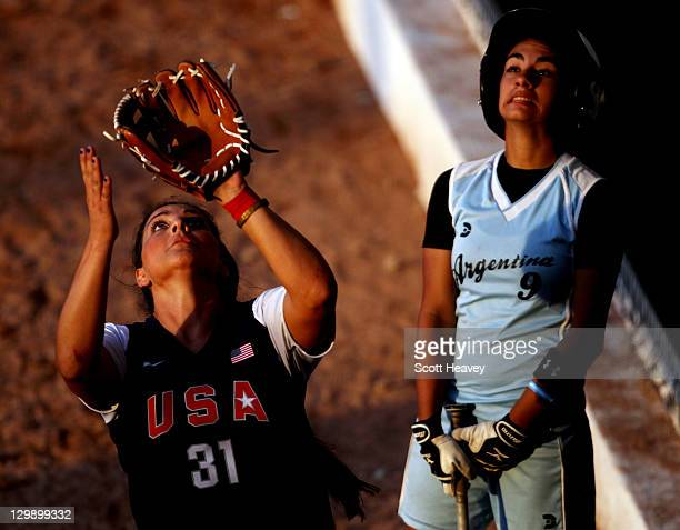 Aldana Gomez of Argentina looks on as Amelia Leles of the USA prepares to take a catch to the Women's Softball Group 1 match between Argentina and...