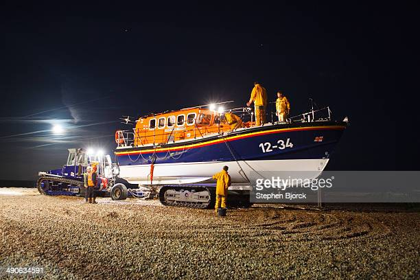 Aldeburgh lifeboat is being cleaned under a full moon after returning from a distress call.