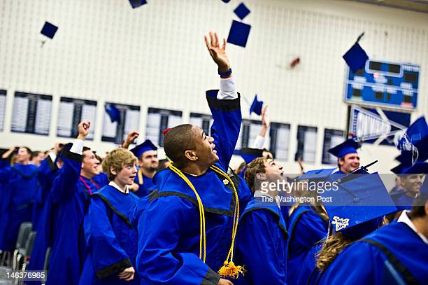 Alden Carpenter center and other members of the first graduation class of Tuscarora High School toss their mortar boards into the air after the...