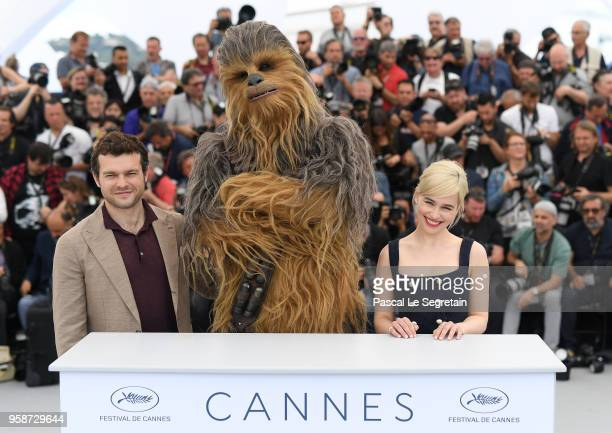 Alden Ehrenreich Chewbacca and Emilia Clarke attend the photocall for 'Solo A Star Wars Story' during the 71st annual Cannes Film Festival at Palais...