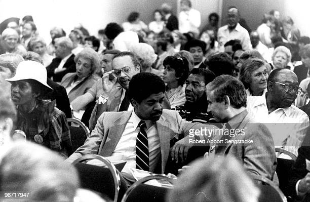 Alderman Dorothy Tillmann sits next to Alderman Timothy Evans who talks to a delegate Sunday morning as they were waiting for Mayor Harold Washington...