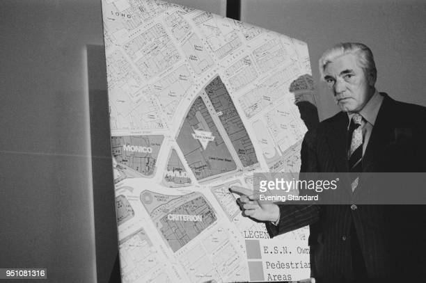 Alderman Herbert Sandford chairman of Westminster Councils' Piccadilly Circus subcommittee showing a scheme for the redevelopment of Piccadilly...