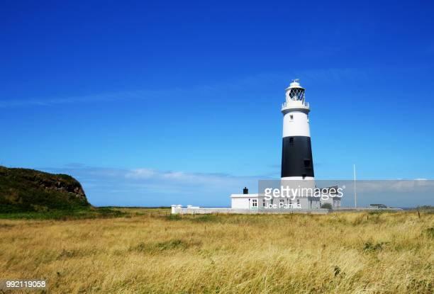 alderney lighthouse - isola di guernsey foto e immagini stock