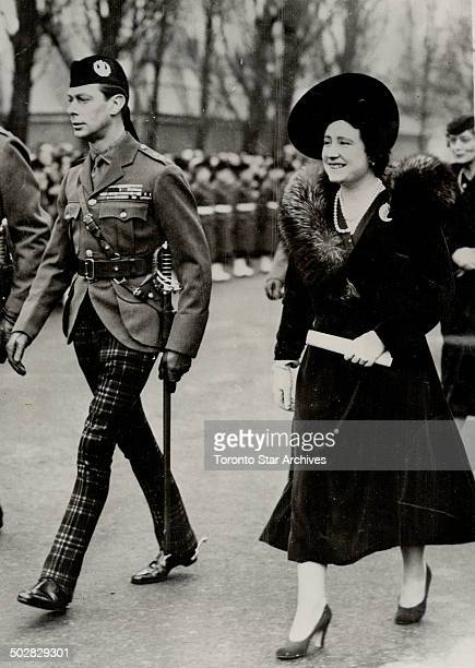 Aldershot; England - King George VI and his smiling Queen walk to the parade grounds to take the salute after attending divine service at the newly...