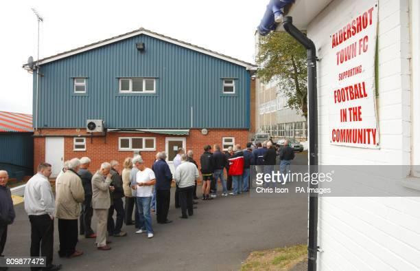 Aldershot Town FC supporters queue for Manchester United tickets at the EBB Stadium Aldershot