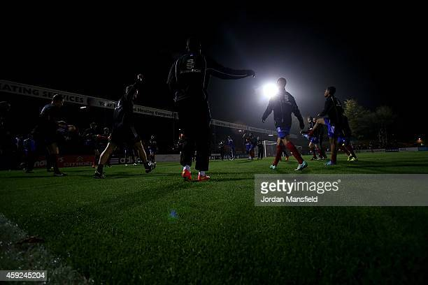 Aldershot warm up ahead of the FA Cup First Round Replay match between Aldershot Town and Portsmouth at The Electrical Services Stadium on November...