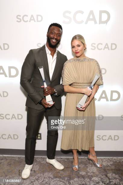 """Aldis Hodge and Sienna Miller attend Sienna Miller Outstanding Achievement In Cinema Award Presentation And """"American Woman"""" Q&A during the 22nd SCAD..."""