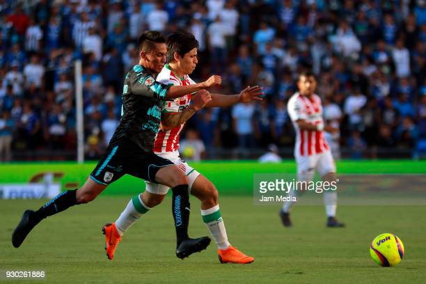 Aldo Arellano of Queretaro and Victor Davila of Necaxa compete for the ball during the 11th round match between Queretaro and Necaxa as part of the...