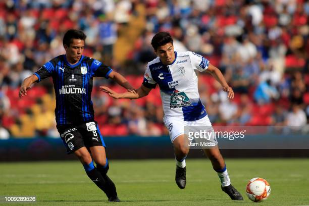 Aldo Arellano of Queretaro fights for the ball with Erick Gutierrez of Pachuca during the second round match between Queretaro and Pachuca as part of...