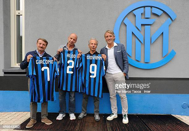 Aldo Baglio Giacomo Poretti Giovanni Storti and head coach of FC Internazionale Roberto Mancini pose before the FC Internazionale Training session at...