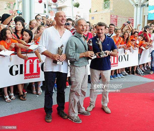 Aldo Baglio, Giovanni Storti and Giacomo Poretti pose with the Giffoni Award during the 2011 Giffoni Experience on July 15, 2011 in Giffoni Valle...