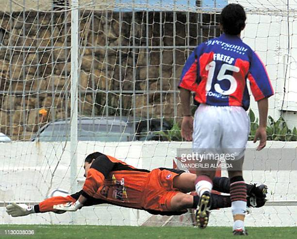 Aldo Bobadilla goalkeeper of Paraguayan soccer team Cerro Porteno tries to stop a shoot by Leo Lima of Brazilian soccer team Vasco da Gama as Lima's...