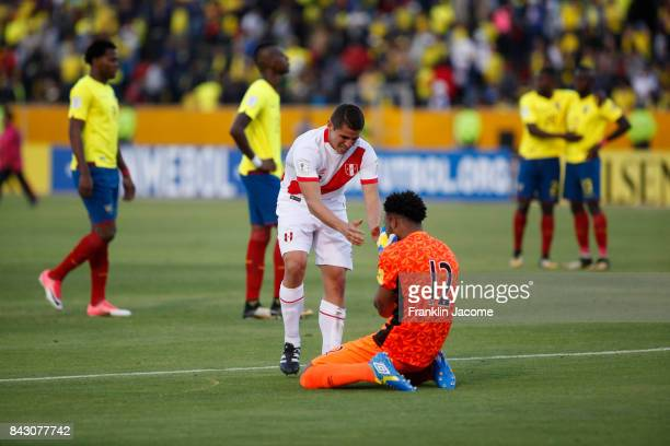 Aldo Corzo and Carlos Caceda of Peru celebrate after a match between Ecuador and Peru as part of FIFA 2018 World Cup Qualifiers at Olimpico Atahualpa...