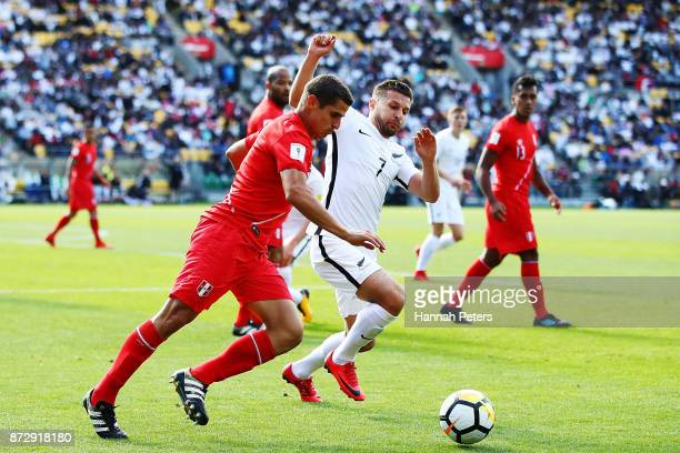 Aldo Corzo of Peru competes with Kosta Barbarouses of the All Whites for the ball during the 2018 FIFA World Cup Qualifier match between the New...
