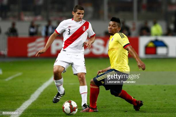 Aldo Corzo of Peru fights for the ball with Frank Fabra of Colombia during match between Peru and Colombia as part of FIFA 2018 World Cup Qualifiers...