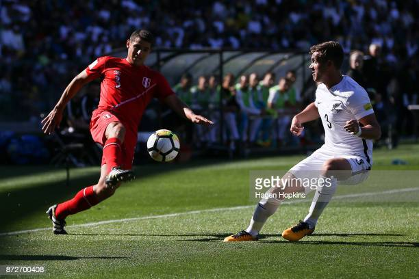Aldo Corzo of Peru looks to evade Deklan Wynne of New Zealand during the 2018 FIFA World Cup Qualifier match between the New Zealand All Whites and...