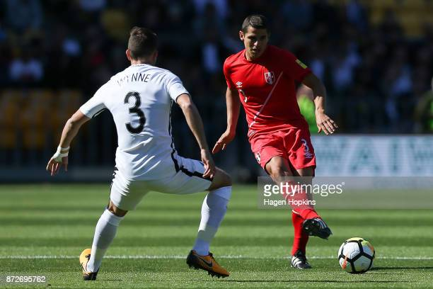 Aldo Corzo of Peru passes under from Deklan Wynne of New Zealand of New Zealand during the 2018 FIFA World Cup Qualifier match between the New...