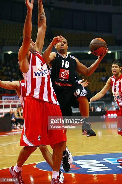 Aldo Curti #10 of Entente Orleanaise competes with Ioannis Bourousis #9 of Olympiacos Piraeus during the Euroleague Basketball Regular Season Game...
