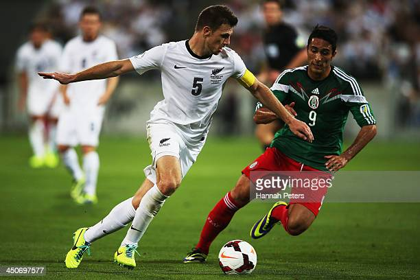 Aldo De Nigris Guajardo of Mexico defends against Tommy Smith of New Zealand during leg 2 of the FIFA World Cup Qualifier match between the New...