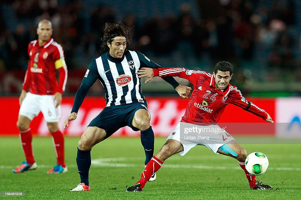 Aldo De Nigris (C) of CF Monterrey challenges Ahmed Fathi during the FIFA Club World Cup 3rd Place Match between Al-Ahly SC and CF Monterrey at International Stadium Yokohama on December 16, 2012 in Yokohama, Japan.